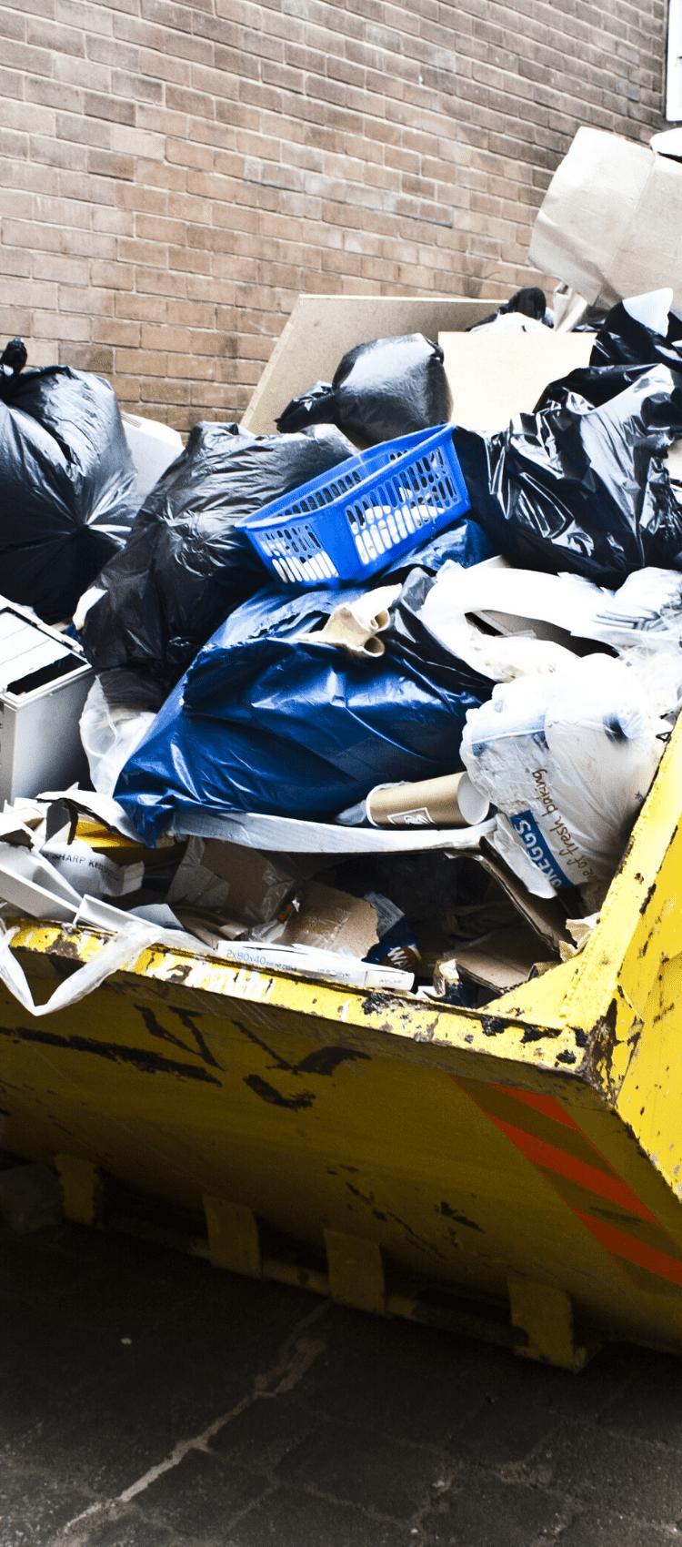 Yellow skip full of trade waste